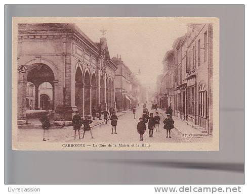 Cpa , Carbonne , La Rue De La Mairie Et La Halle , Non Voyagé - France