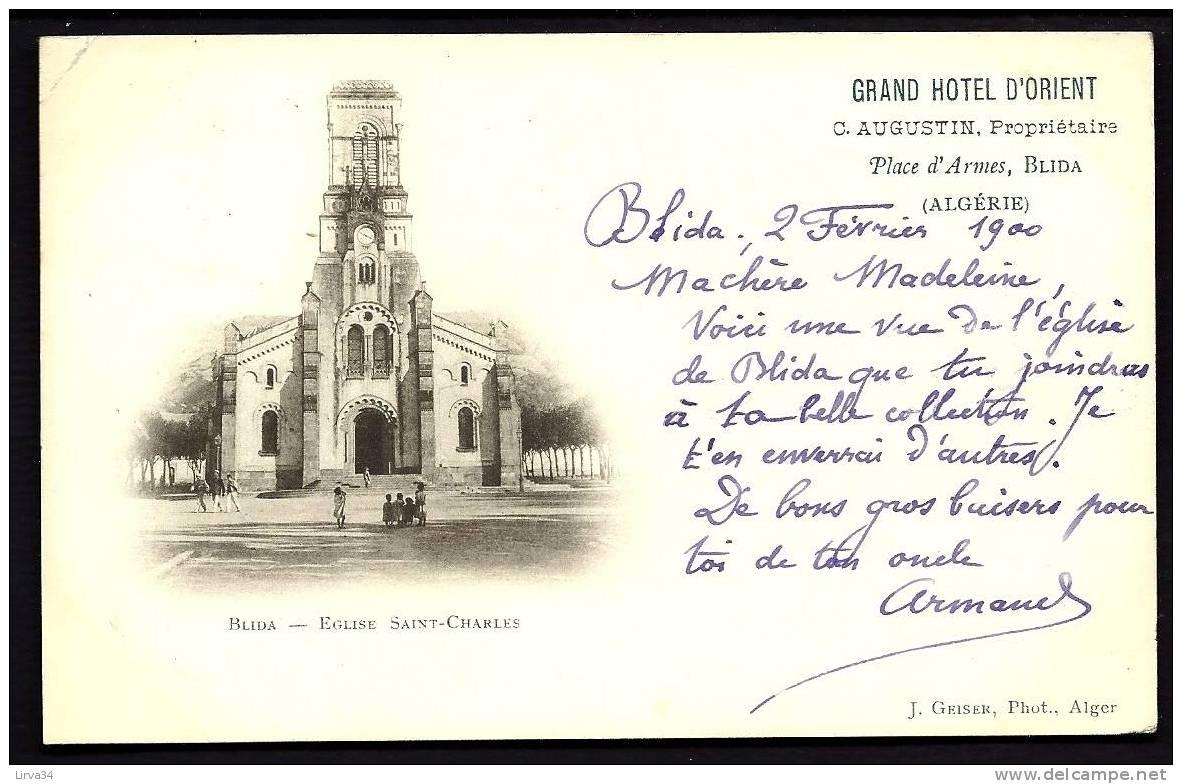 CPA  PRECURSEUR- ALGÉRIE-  BLIDA- EGLISE SAINT-CHARLES EN 1900- GROS PLAN DE FACE AVEC ANIMATION- PUB GRAND-HOTEL - Blida
