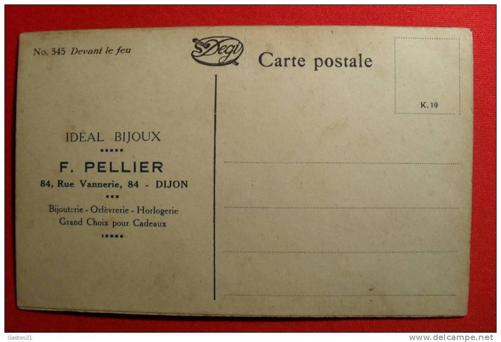 P. -  N° 545  DEVANT LE FEU - IDEAL BIJOUX - F. PELLIER - DIJON - FEMME SE CHAUFFANT DEVANT CHEMINÉE - CARTE PEINTE - - Publicité