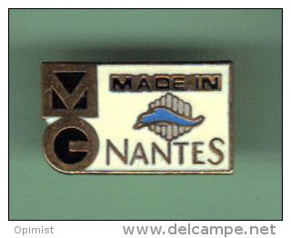 33507-Pin's.MG Nantes.signé Pavageau. - Villes