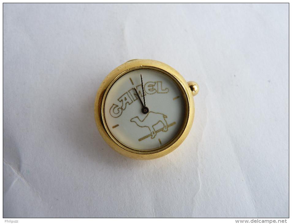 rare pin 39 s montre camel fonctionne avec 1 pile changer. Black Bedroom Furniture Sets. Home Design Ideas