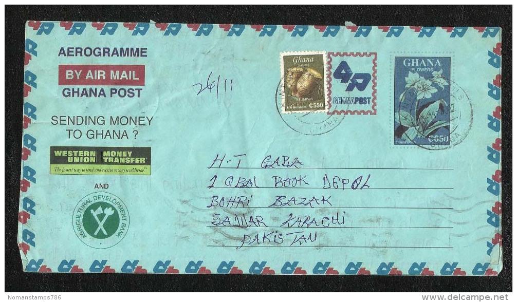 Ghana Air Mail Postal Used Aerogramme With Stamps Ghana To Pakistan  Drums Flower Western Union - Ghana (1957-...)