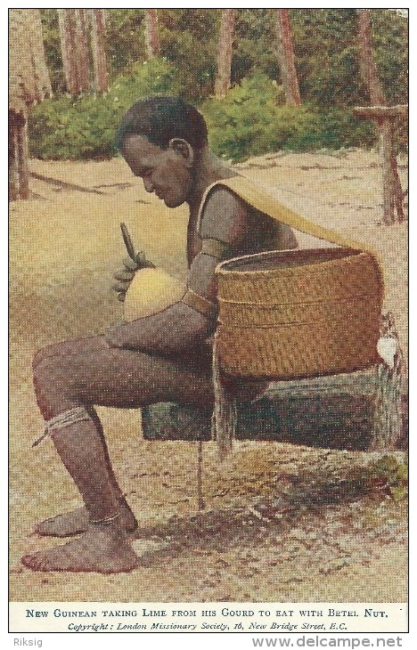 New Guinean Taking Lime From His Gourd To Eat With Betel Nut.     S-2498 - Papua New Guinea