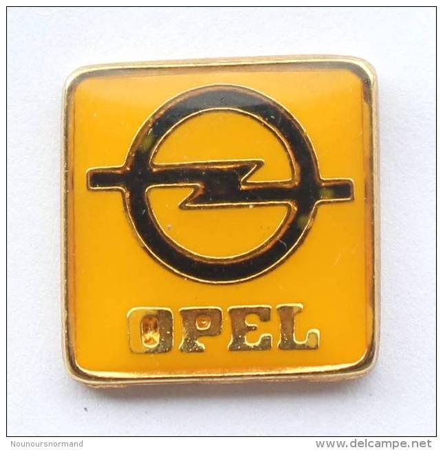 Pin's OPEL - Logo Sur Fond Jaune - Zamac - F446 - Opel
