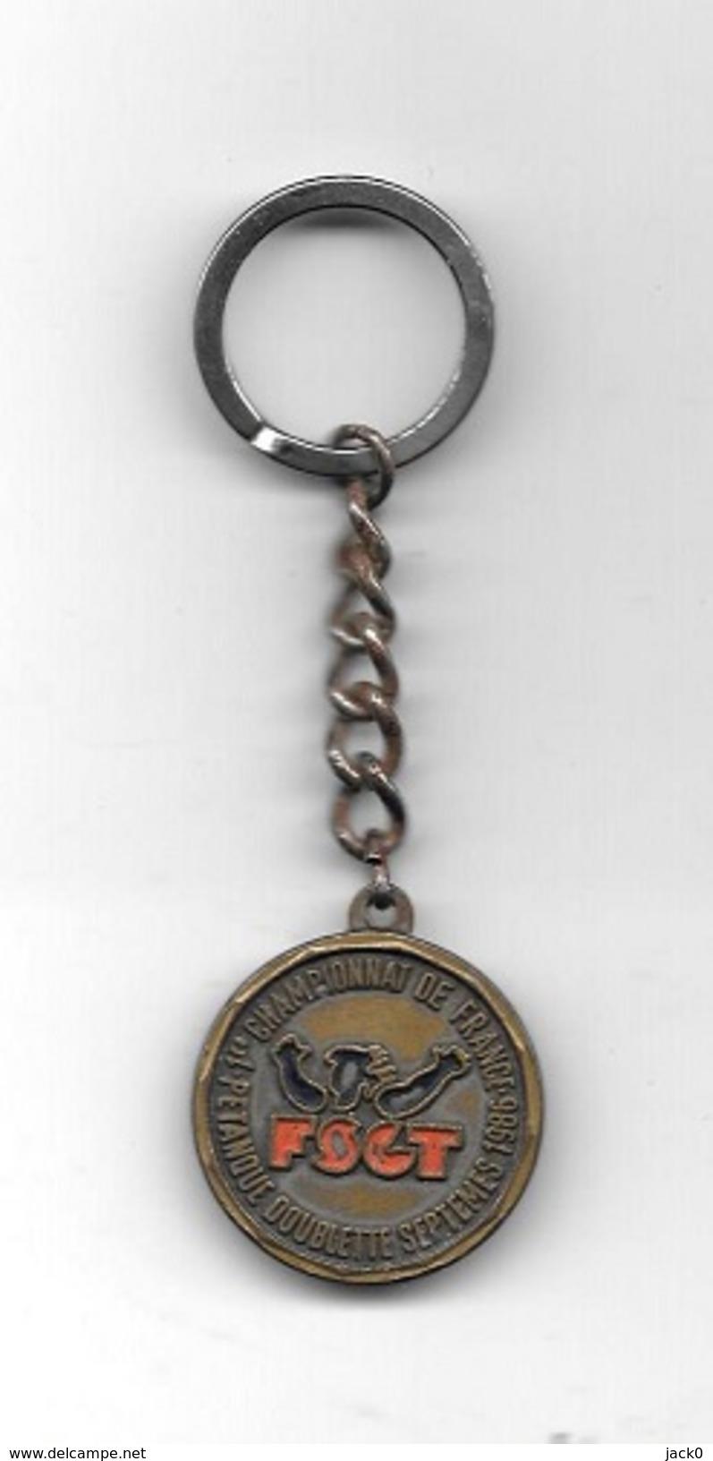 Porte-clés  Ancien, Sport  Pétanque FSGT, 1 Er  CHAMPIONNAT DE FRANCE PETANQUE  DOUBLETTES  SEPTEMES 1986 - Pétanque