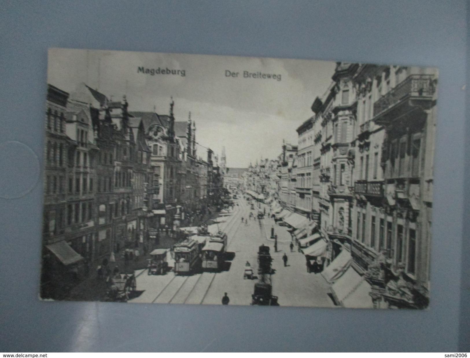 CPA ALLEMAGNE MAGDEBURG DER BREITEWEG TRAMWAYS VOITURES ANCIENNES COMMERCES - Magdeburg