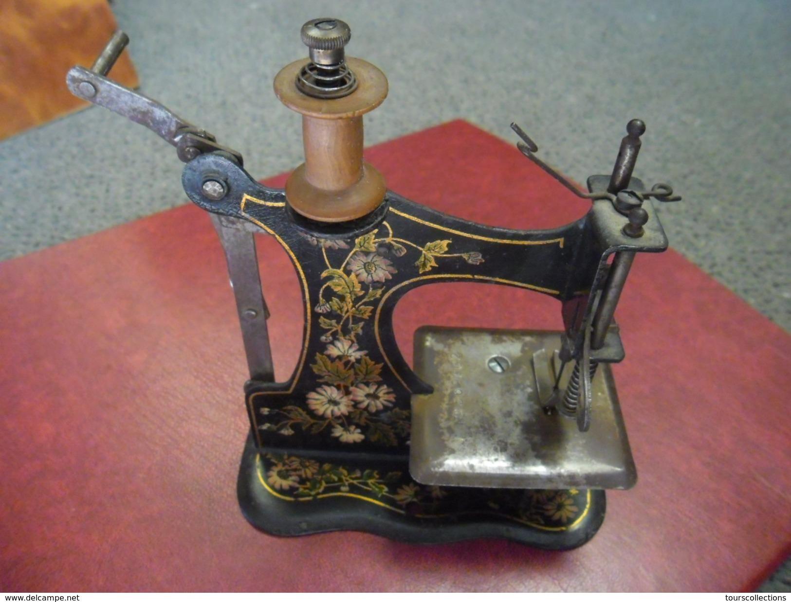 Machine A Coudre Ancienne rare ancienne machine a coudre de poupee marque casige germany art nouveau  de 1903 - jouet en tole - sewing machine toy (numéro d'objet: #442193998)