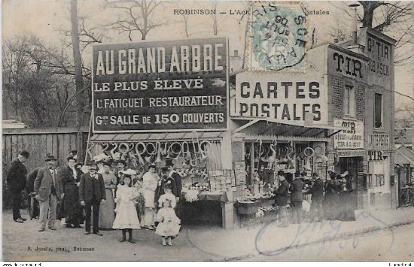 CPA Sur Le Thème De La Carte Postale Circulé Carte Sur La Carte Robinson Devanture De Magasin Marchand - Correos & Carteros