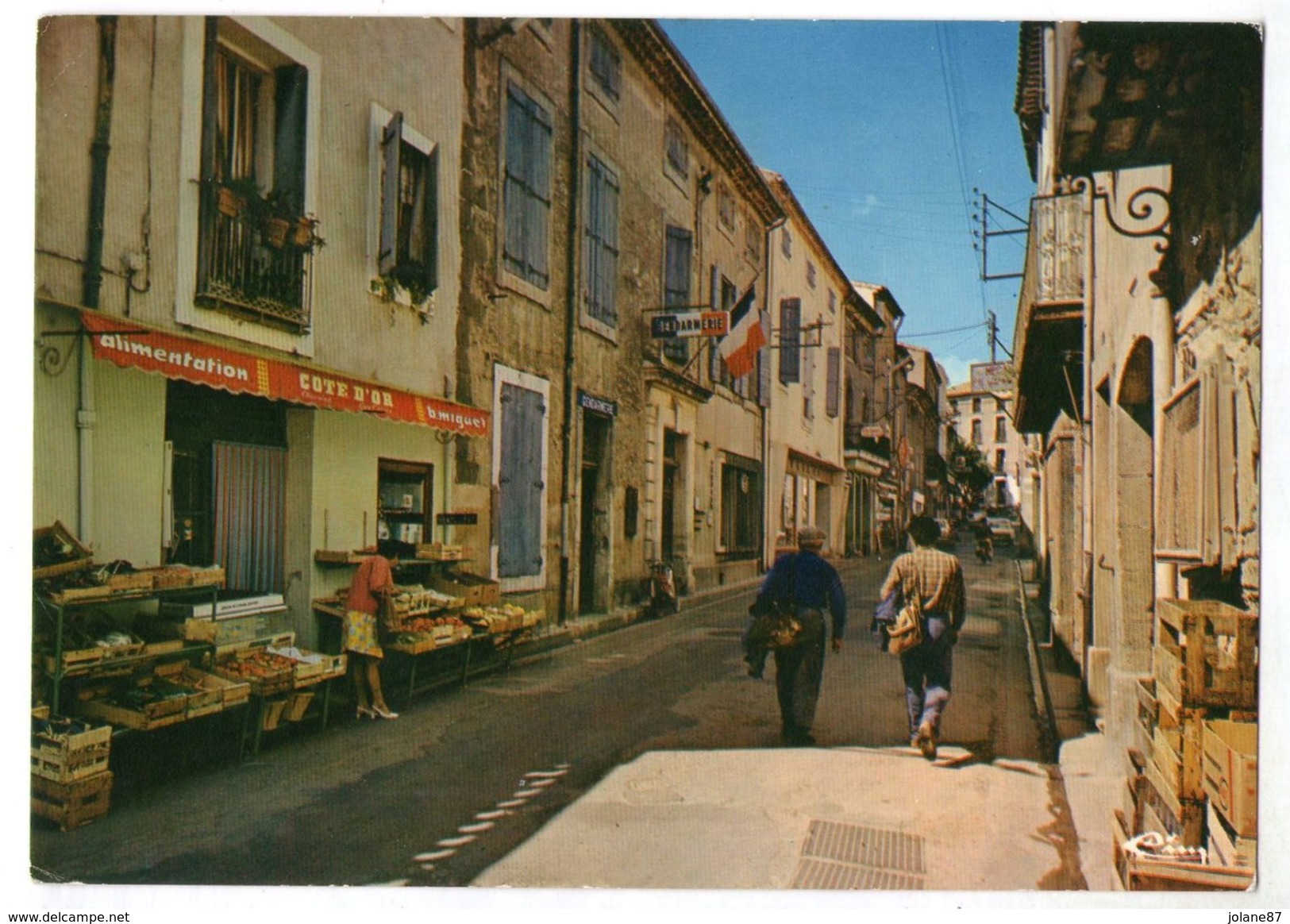 CPM  34     SERVIAN     1985    GRANDE RUE      MAGASIN ALIMENTATION   GENDARMERIE - France