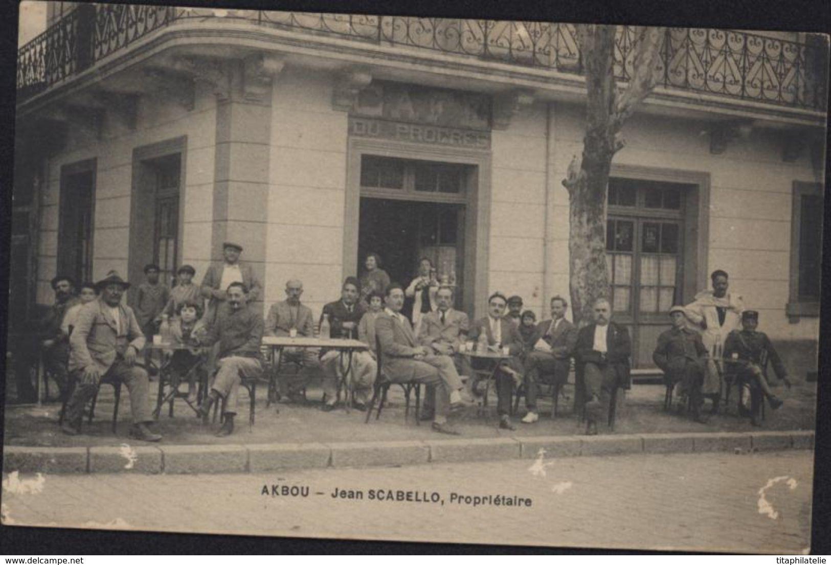 CPA Algérie Akbou Jean Scabello Propriétaire Vue Café Du Progrès Très Animée - Algeria