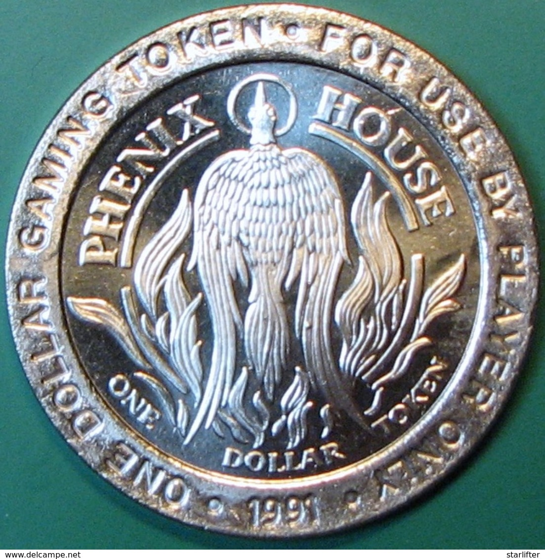 $1 Casino Token. Phenix House, Cripple Creek, CO. 1991. NEW. J32. - Casino