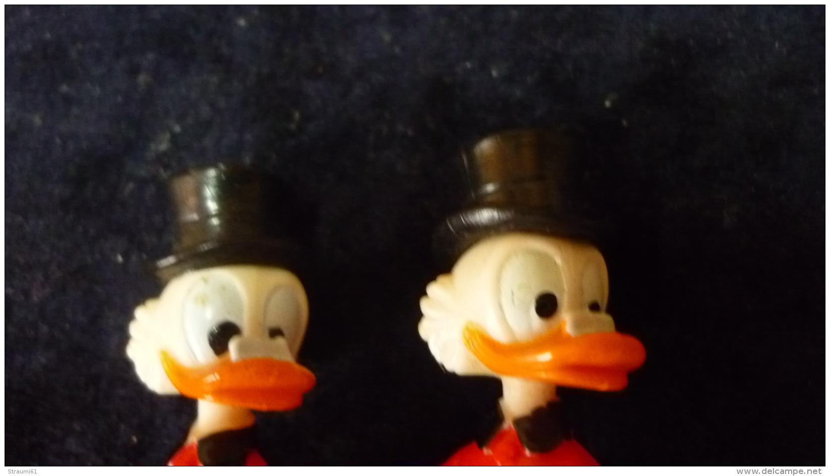 Ü Ei   Dagobert Duck  , Unterschiedliche Bemalung - Ü-Ei