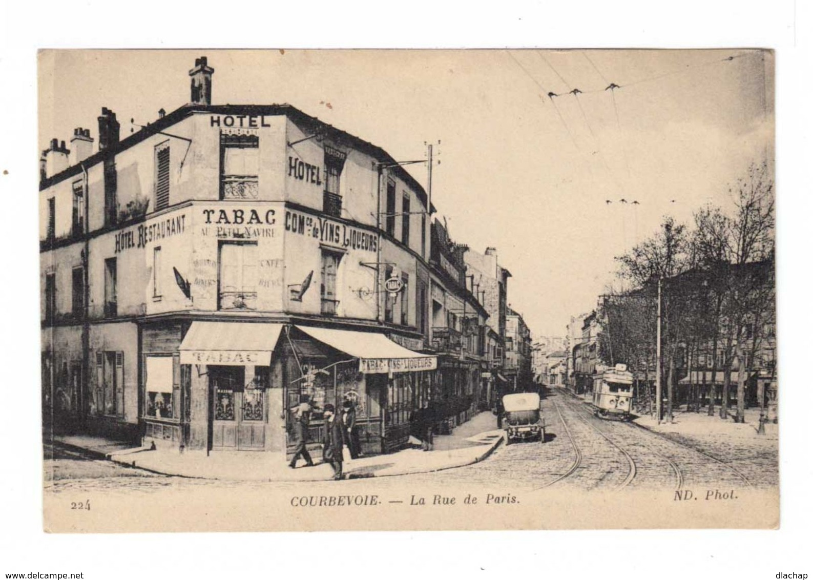 Courbevoie. La Rue De Paris. Tabac, Hôtel. Tramway. (2446) - Courbevoie