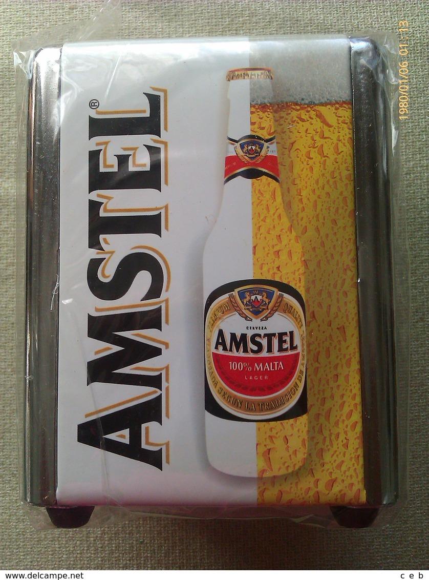 Servilletero Cerveza Amstel 100 Malta. España - Servilletas Publicitarias