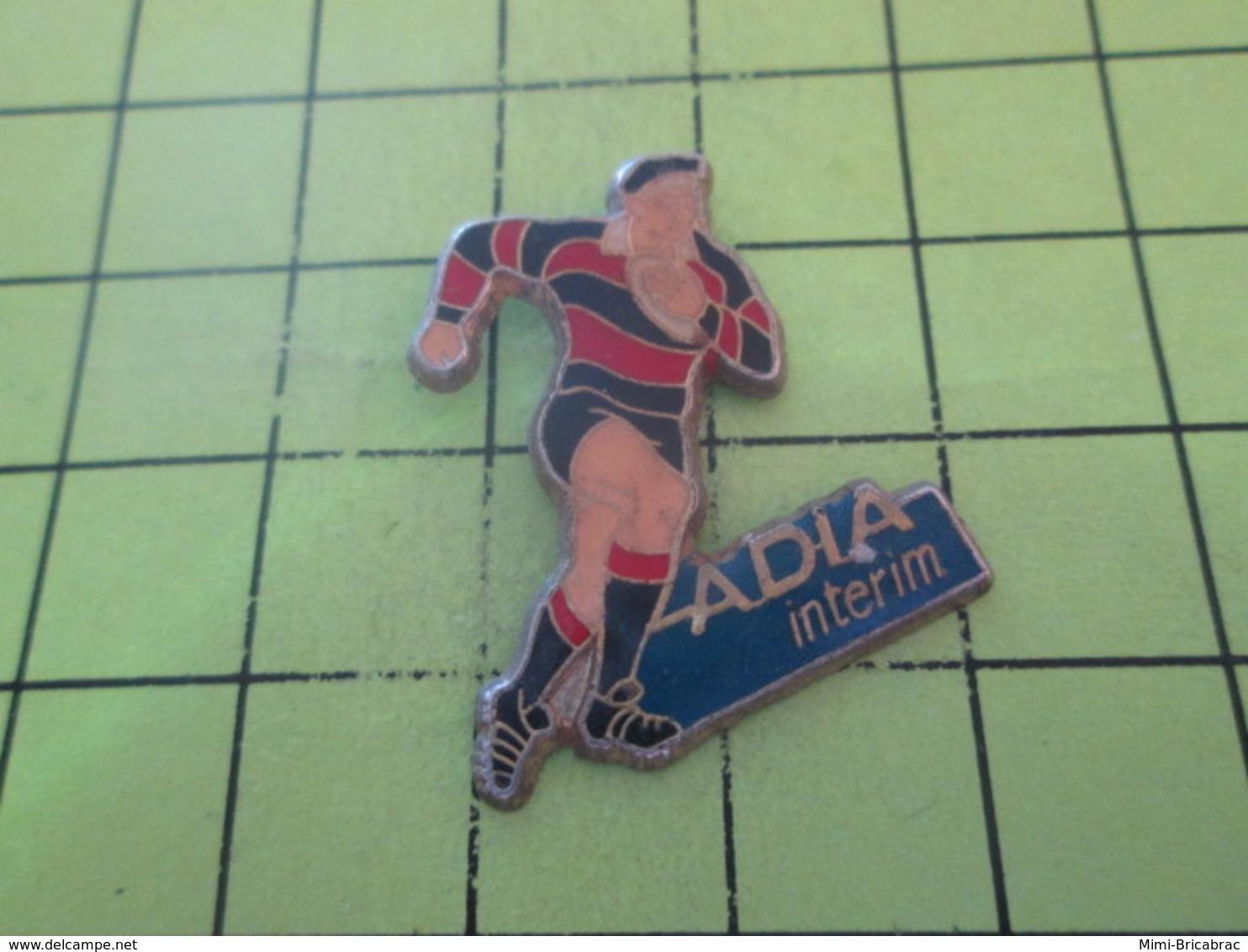 811J PINS PIN'S / Beau Et Rare : Thème SPORTS / RUGBY ADIA INTERIM - Rugby