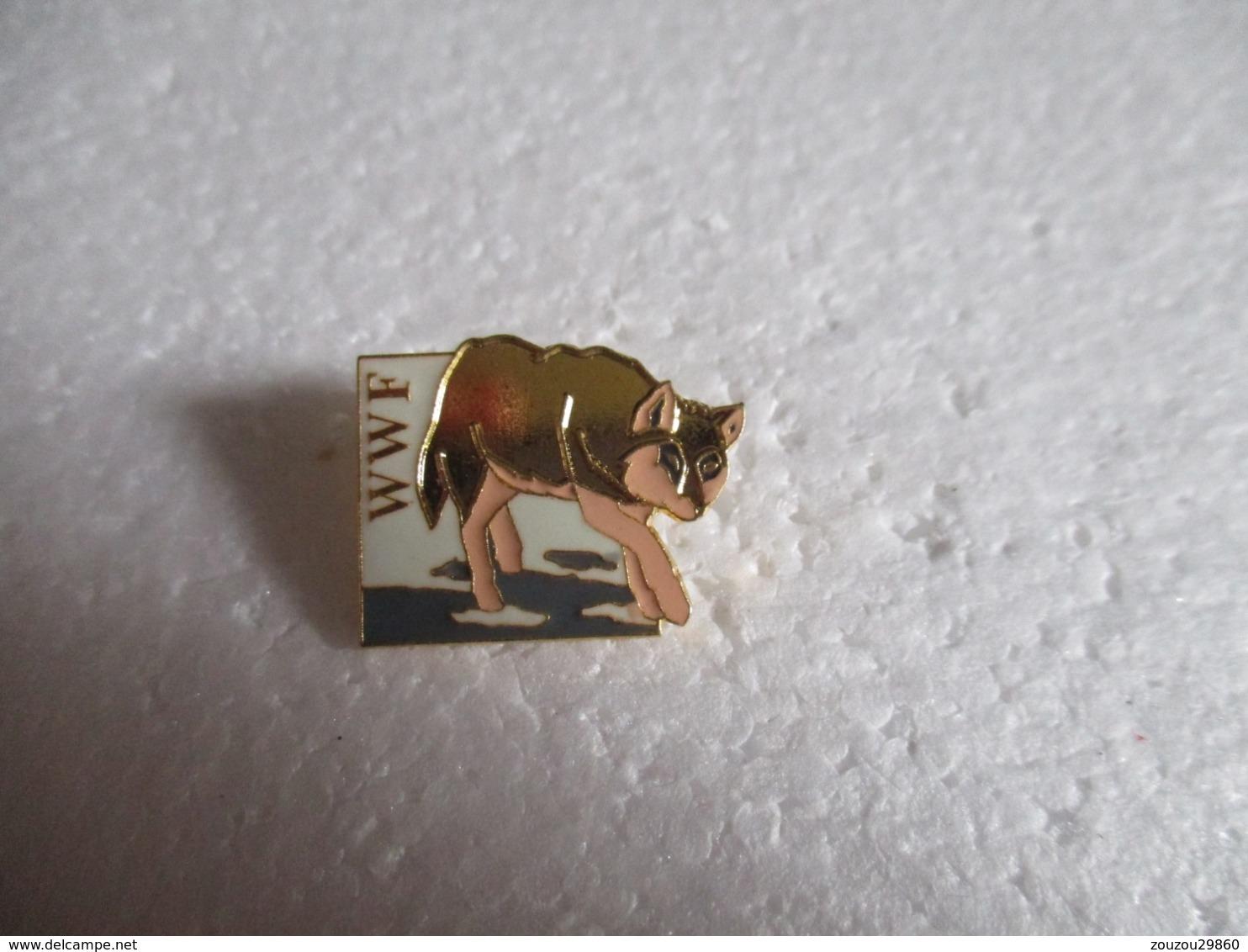 Pin's Animalier WWF Loup. - Animaux