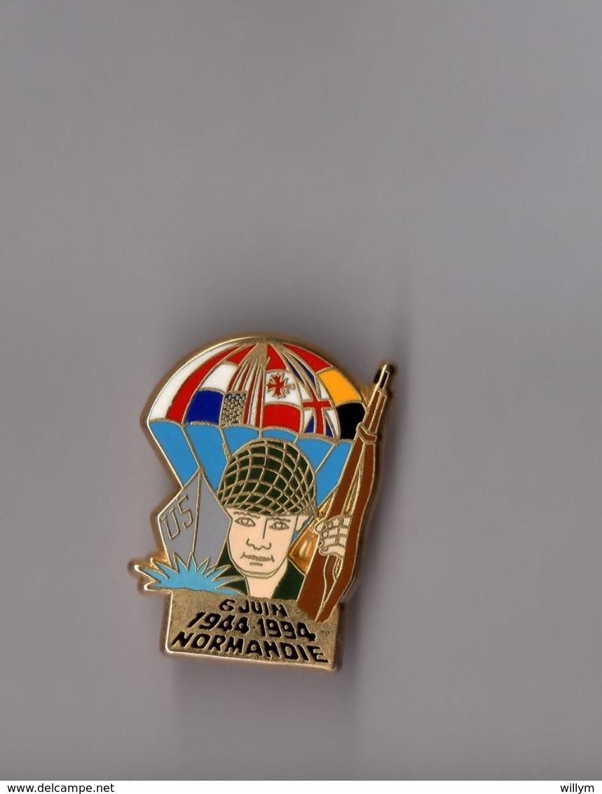Pin's Armée / 50ème Anniversaire D-Day Débarquement Normandie 6 Juin 1944 (zamac Signé Ballard Dessin De B Houel) - Militaria