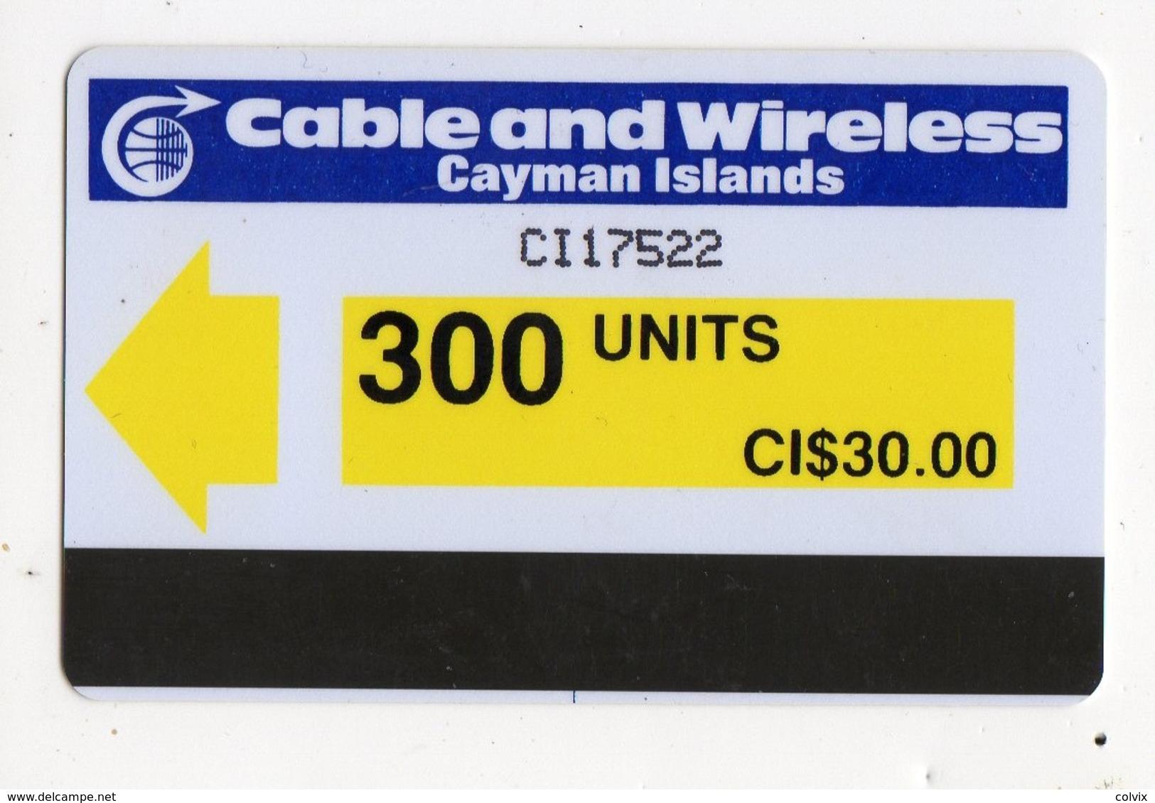 CAYMAN ISLANDS REF MV CARDS CAY-AU2 AUTELCA 300U  Année 1986 CN : CI17522 Yellow Arrow - Iles Cayman