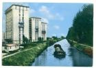 CHELLES (77) - CPM - Le Canal Et Les Tours ... Péniche, Bâtiments HLM - Unclassified
