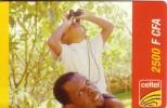 NIGER PREPAYEE PREPAID CARD CELTEL 2500 CFA  PETIT GARCON SMALL BOY BINOCULARS JUMELLES CANNOCCHIALE - Niger