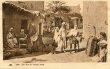 CPA AFRIQUE DU NORD UNE RUE DE VILLAGE ARABE - Cartes Postales