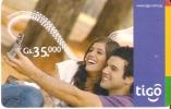 TARJETA DE PARAGUAY DE TIGO DE GS35000 DE UNA PAREJA CON MOVIL - Paraguay
