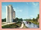 CPSM -  02 - BOURG ET COMIN - LE SILO ET LE CANAL - PENICHE - BATELLERIE - - France