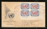 JAPAN - 1957 UNITED NATIONS FDC 8.3.57 (UN EMBLEM & FLAGS COVER WITH BLOCK OF 4 STAMPS) TO USA - FDC
