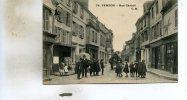 Vernon  27   La  Rue  Carnot Tres Animée-et Attelage Boucherie-Epicerie Et Articles De Chasse - Vernon