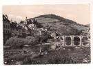 ### Cp , 12 , Saint-Geniez-D'Olt , Le Lot - Le Pont - L'Eglise Paroissiale , Voyagée 1957 - Altri Comuni