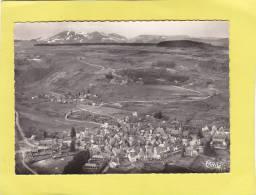 CPSM - 63 - BESSE En CHANDESSE  - Vue Générale Aérienne Et Panorama Sur La Chaine Des Dores - Otros Municipios