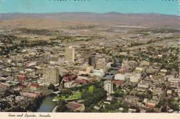 Cp , RENO And SPARKS , Aerial View , Nevada Showing The Hotels With Truckee River In Foreground - Reno