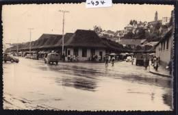 Madagascar - Tananarive ; Carrefour Sous La Pluie - Voitures, Camionnettes, Passants (1957) (-494) - Madagascar