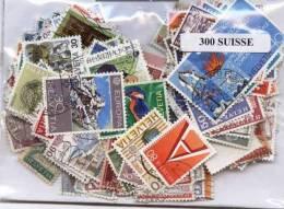SUISSE, Lot De 300 Timbres Tous Differents Neufs Et Oblitérés. Satisfaction Assurée - Suisse