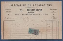 1923 - FACTURE L. ROCHER - BIJOUTERIE JOAILLERIE & ORFEVRERIE REPARATION DE LUNETTERIE - 123 RUE DE ROME PARIS - FISCAL - Petits Métiers