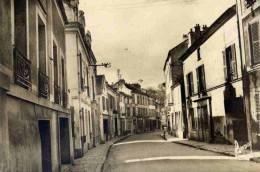 CPSM 91 YERRES LA RUE DE PARIS - Yerres