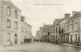 """44 - SOUDAN - LA ROUTE DE LA GARE & LA PLACE DE L'EGLISE - """" HÔTEL DES VOYAGEURS - BAUDOUIN """" - France"""