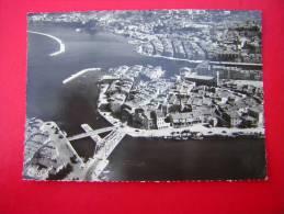 CPSM 13 MARTIGUES  VUE PANORAMIQUE AERIENNE  VOYAGEE 1957 TIMBRE   CACHET ET FLAMME - Martigues