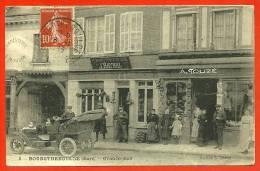TOP CPA 27 BOURGTHEROULDE Eure - Grande Rue - Boutique De Vêtements A. TOUZE (éditeur) & Chaussures J. Raynal - AUTO - Bourgtheroulde