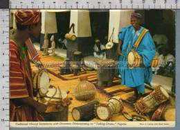 R9309 NIGERIA TRADITIONAL MUSICAL INSTRUMENTS WITH DRUMMERS TALKING DRUMS VG - Nigeria