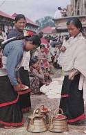 DUBAI - WOMEN OF KATMANDU VALLEY PREPARING FOR WORSHIP - Nepal
