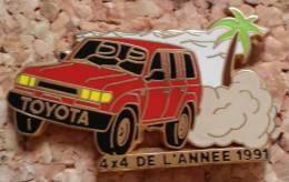 PIN´S AUTOMOBILE TOYOTA 4X4 DE L´ANNEE 1991 ARTHUS BERTRAND PARIS - Toyota
