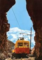 (P) Arrivée Du Tramway Du Mont-blanc Au Nid D'aigle (2.600m).aiguille De Bionnassay(4.061m).T B. - Tranvía
