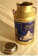 Blechdose  LINDT  SWISS PREMIUM  CHOCOLATE  -  In Milchkannenform , Höhe Ca. 16,5 Cm - Scatole