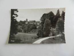 Cp  Bouclans L église  Et Le Chateau - Frankrijk