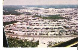 """Thompson, Manitoba Looking Eastward With The """"Deerwood"""", """"Staghorn"""", """"Beaver"""", Residential Area In Foreground. - Manitoba"""