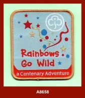 "A8658  (2010)  ""Rainbows Go Wild - A Centenary Adventure""  (Girl Guide Badge) - Scouting"