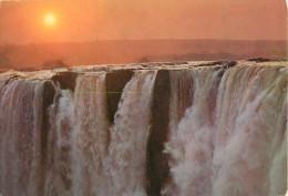 CPSM Zambie-Sunrise Over The Victoria Falls   L1344 - Zambia