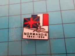 (pin713e) Pin´s Pins / Thème : MILITARIA /   NORMANDIE  JUIn 1944 50e ANNIVERSAIRE TYPHOON VU DE FACE DRAPEAUX FRANCE ET - Militaria