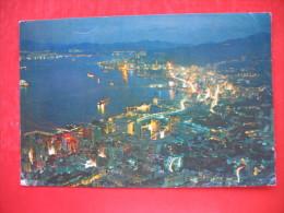 """BIRD""""S EYE OF CENTRAL AND EASTERN DISTRICTS OF HONG KONG WITH TSIMSHATSUI KOWLOON,AT NIGHT - Cina (Hong Kong)"""